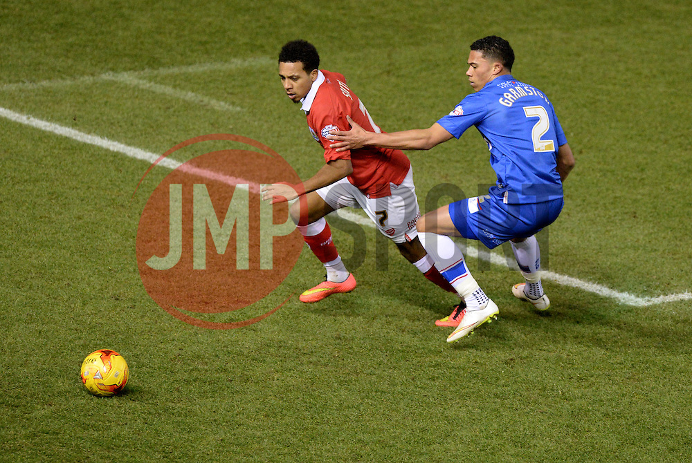 Bristol City's Korey Smith and Gillingham's Matt Fish chase down the ball. - Photo mandatory by-line: Alex James/JMP - Mobile: 07966 386802 - 29/01/2015 - SPORT - Football - Bristol - Ashton Gate - Bristol City v Gillingham - Johnstone Paint Trophy Southern area final