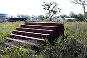 A set of stairs leads nowhere on what once was a home on the Mississippi Gulf of Mexico coast May 5, 2010.  Almost 5 years after hurricane Katrina laid the shore bare much remains to be rebuilt with another natural disaster - the BP oil spill - looming offshore.  REUTERS/Rick Wilking (UNITED STATES)