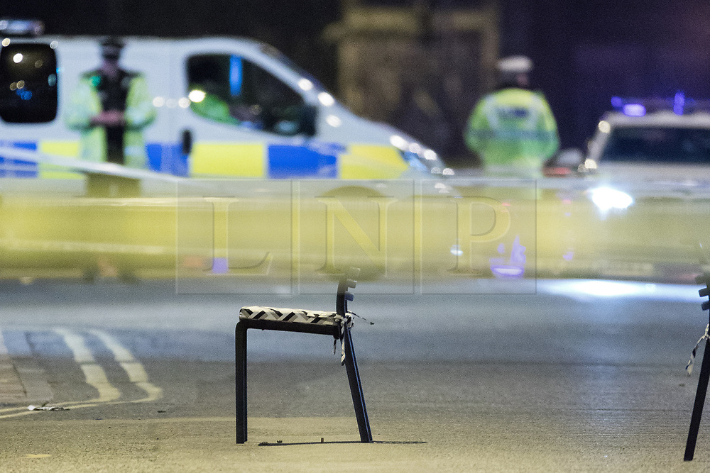 © Licensed to London News Pictures. 03/05/2017. Manchester, UK. Police close off Deansgate in central Manchester following a drive by shooting outside the Living Room nightclub this evening . In 2014 a similar drive be shooting incident prompted months of police enquiries . Photo credit: Joel Goodman/LNP