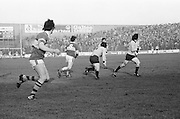 Kerry has possession as Dublin cuts in front of him to tackle during the All Ireland Senior Gaelic Football Semi Final, Dublin v Kerry in Croke Park on the 23rd of January 1977. Dublin 3-12 Kerry 1-13.