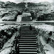 Excavations by DAFA (1951-1963), under the direction of Daniel Schlumberger, revealed a monumental staircase that swept up from the foot of the hill to its very top (55 meters long; 7 meters wide), interrupted along the way by four wide terraces. <br />