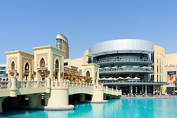 View of Dubai Mall and footbridge over lake in United Arab Emirates