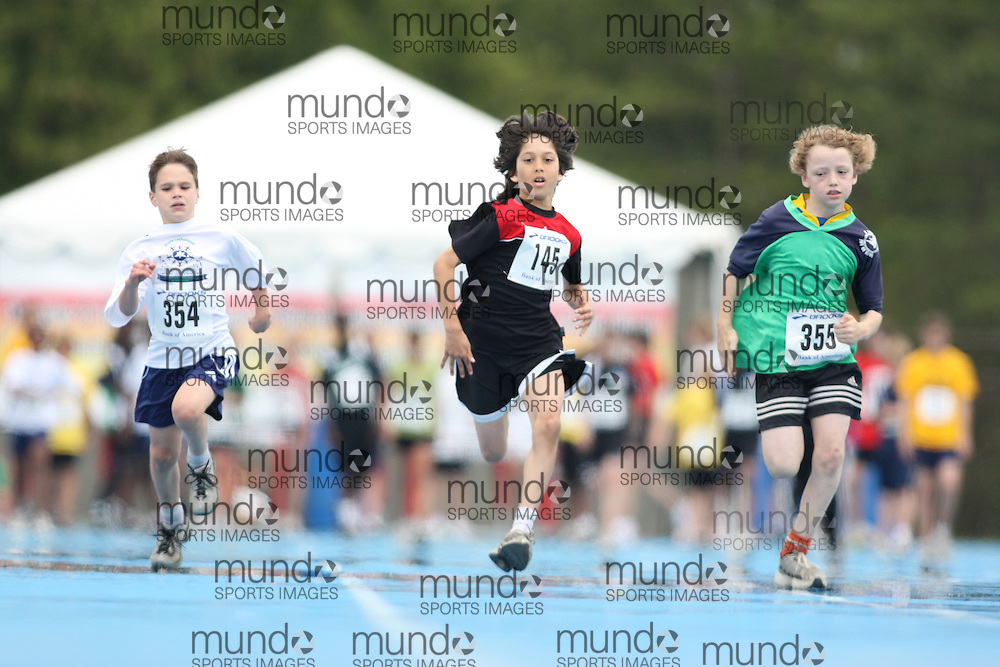 (Ottawa, Ontario---20/06/09)   Nicholas Wark (354);  Cameron Hunter (145); and  Rowan Warner (355)\ competing in the 100m at the 2009 Bank of America All-Champions Elementary School Track and Field Championship. www.mundosportimages.com / www.msievents.