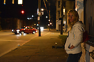 Candace Greene, 33, a former nurse who is now a heroin-addicted prostitute, waits on the street for costumers in the McMicken neighborhood in Cincinnati, Ohio, an epicenter of a growing heroin crisis in the U.S. Candace says in her early 20s, she began selling and using oxycotin she acquired from her nursing job, which cost $40 a pill. A cousin told her heroin was a cheaper at $20 a high, so she began using heroin. She has three kids who are in the legal custody of her sister. Candace is homeless, and lives in an abandoned building.