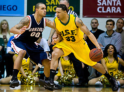 January 30, 2010; San Francisco, CA, USA;  San Francisco Dons forward Dior Lowhorn (33) is guarded by Gonzaga Bulldogs center Robert Sacre (00) during the first half at the War Memorial Gym.   San Francisco defeated Gonzaga 81-77 in overtime.