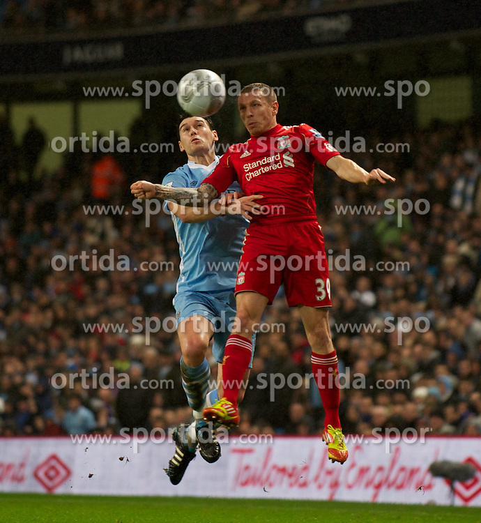 11.01.2012, Etihad Stadion, Manchester, ENG, Carling Cup, Manchester City vs FC Liverpool, Halbfinale, im Bild Liverpool's Craig Bellamy in action against Manchester City's Gareth Barry during the football match of English Carling Cup, Halffinal, between Manchester City and FC Liverpool at Etihad Stadium, Manchester, United Kingdom on 2012/01/11. EXPA Pictures © 2012, PhotoCredit: EXPA/ Propagandaphoto/ David Rawcliff..***** ATTENTION - OUT OF ENG, GBR, UK *****