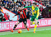 AFC Bournemouth defender Adam Smith and Norwich City midfielder Jonathan Howson during the Barclays Premier League match between Bournemouth and Norwich City at the Goldsands Stadium, Bournemouth, England on 16 January 2016. Photo by Graham Hunt.