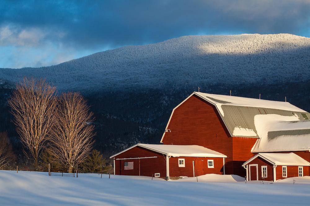 Cold, snowy winter farm scene in Waterbury Center, Vermont