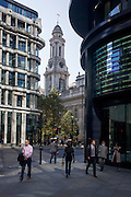 The spire of Royal Exchange and lunchtime City of London workers on Threadneedle Street.