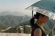 Chinese tourist on Great Wall with umbrella