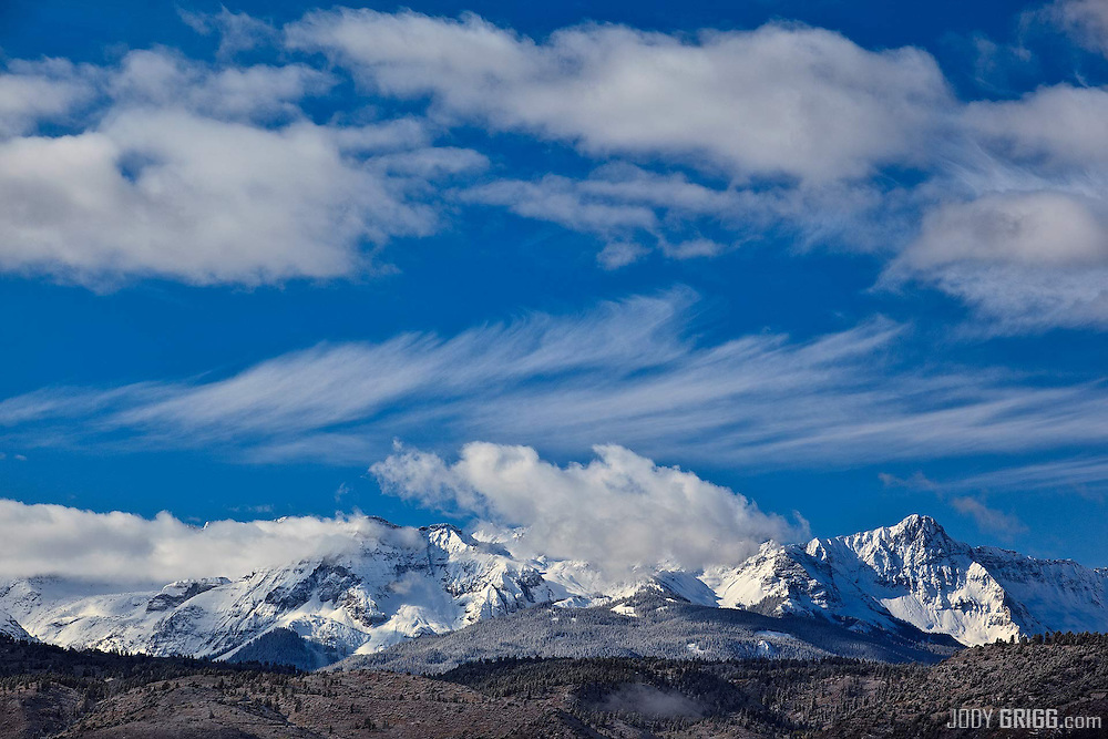 Clouds swirl low and high on the San Juan mountains outside of Ridgway on a cold October morning.