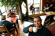 Eleazar Delgado is owner of Cafe Jumping Bean, an eclectic community gathering post on 18th St. in the middle of Chicago's predominately Mexican community of Pilsen. © 2013 Brian J. Morowczynski ViaPhotos