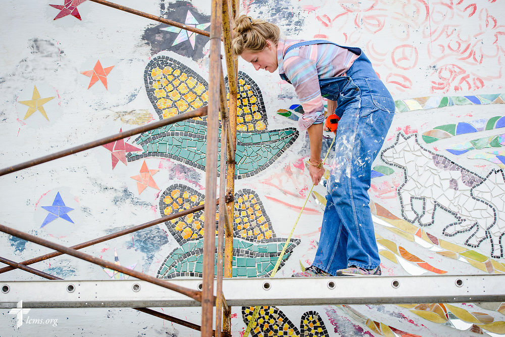 Artist Rachel Ziegler works on her mural project commemorating the 500th anniversary of the Lutheran Reformation on the building across from Zion Lutheran Church, Worms, Neb., on Saturday, Sept. 23, 2017. LCMS Communications/Erik M. Lunsford