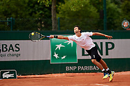 Paris, France - 2017 June 02: Marcelo Melo from Brazil plays a forehand while his men's double match second round during tennis Grand Slam tournament The French Open 2017 (also called Roland Garros) at Stade Roland Garros on June 02, 2017 in Paris, France.<br /> <br /> Mandatory credit:<br /> Photo by © Adam Nurkiewicz<br /> <br /> Adam Nurkiewicz declares that he has no rights to the image of people at the photographs of his authorship.<br /> <br /> Picture also available in RAW (NEF) or TIFF format on special request.<br /> <br /> Any editorial, commercial or promotional use requires written permission from the author of image.