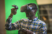 Nana Boadum, a graduate student, tries out the virtual reality headset during the ribbon cutting ceremony for the Gladys W. and David H. Patton College of Education's newly renovated McCracken Hall held on January 27, 2017.