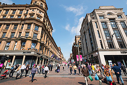 View of historic buildings on Buchanan Street, popular shopping street,  in central Glasgow United Kingdom