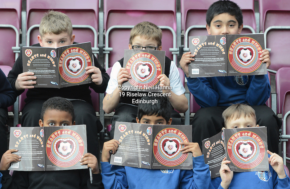 JP License<br /> Wednesday 3 December, Tynecastle Park<br /> <br /> Pic Caption<br /> The young authors of the stories in the book get their eyes down.<br /> <br /> Heart of Midlothian FC help local Edinburgh primary school pupils launch a <br /> special book of footballing stories written by the children.<br /> &lsquo;Hearts and Minds&rsquo; is a collection of tales penned by the P5-7 pupils at Dalry Primary <br /> School, which is just around the corner from the Tynecastle club.<br /> They put the short stories together with the help of local author Mary Turner <br /> Thomson and P7 teacher Graeme Hawkins.<br /> <br />  Neil Hanna Photography<br /> www.neilhannaphotography.co.uk<br /> 07702 246823