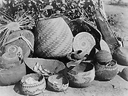 Group Karok baskets some with decoratvie woven patterns and some with lids, c1923.  Native American Indian. Photograph by Edward Curtis (1868-1952).