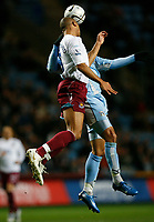 Photo: Steve Bond.<br /> Coventry City v West Ham United. Carling Cup. 30/10/2007. Anton ferdinand beats Leon Best to a goalmouth header