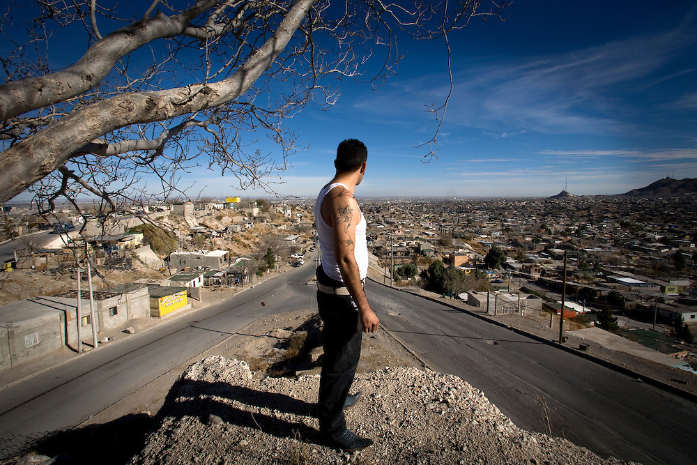 Resident of Juarez looking at the city that become a war zone between the drug cartels and every day aroun20-30 people been assassinates..Friday December 19.2008.