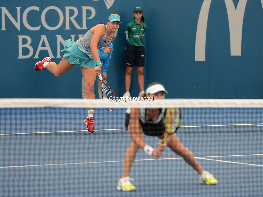 09.01.2014. Brisbane, Queensland, Australia.  L-R, Sabine Lisicki (GER) plays doubles with partner Martina Hingis (SUI) at net. Brisbane International 2015,