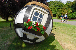 "© Licensed to London News Pictures. 03/07/2019. LONDON, UK. ""Tudor Ball"", 2019, by Lars Fisk. Frieze Sculpture opens in Regent's Park, London's largest free display of outdoor art.  Works from 23 international artists are on display 3 July to 6 October 2019.  Photo credit: Stephen Chung/LNP"