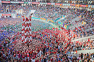 Colla Joves Xiquets de Valls.'Castellers' building human tower, a Catalan tradition.Biannual contest. bullring.Tarragona, Spain