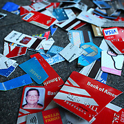 Cut up credit and debit cards are piled in front of the Chase Bank on 4th Avenue on Saturday, October 15, 2011 in Seattle. About 5,000 people joined Occupy Seattle protesters that have been camped at Westlake Park for two weeks. The demonstration is an offshoot of the Occupy Wall Street protest in New York. Saturday was dubbed as a global day of action by the movement. (Joshua Trujillo, seattlepi.com)