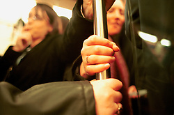 UK ENGLAND LONDON 13MAR02 - Commuters hold on to a handrail on an overcrowded London underground train. ..The London Underground is a rapid transit system serving a large part of Greater London and neighbouring areas of Essex, Hertfordshire and Buckinghamshire in the UK. The Underground has 270 stations and about 400 km of track, making it the longest metro system in the world by route length; it also has one of the highest number of stations and transports over three million passengers daily...jre/Photo by Jiri Rezac..© Jiri Rezac 2002