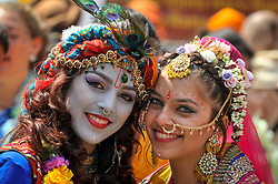 "© Licensed to London News Pictures. 18/06/2017. London, UK. Girls dressed as (L to R) Lord Krishna and consort Radha at the head of the parade.  Devotees celebrate the annual Rathayatra festival (""cart festival""), in central London.  Hare Krishna followers towed three huge decorated carts from Hyde Park corner to Trafalgar Square, singing and dancing all the way.  Photo credit : Stephen Chung/LNP"