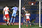 Christopher Pollard Referee punches away the danger during the EFL Sky Bet League 1 match between Coventry City and Rotherham United at the Trillion Trophy Stadium, Birmingham, England on 25 February 2020.