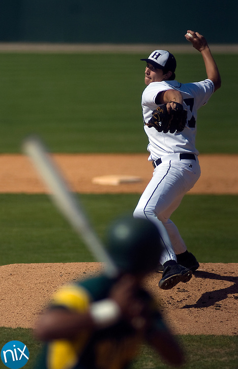 Hickory Ridge's Colten Love (17) pitches against Central Cabarrus Wednesday afternoon during a semifinal game of the Intimidators Classic at Fieldcrest Cannon Stadium.