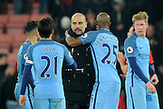 Manchester City manager Josep Guardiola celebrates the 2-0 win over Bournemouth at full time with Fernandinho (25) of Manchester City and David Silva (21) of Manchester City during the Premier League match between Bournemouth and Manchester City at the Vitality Stadium, Bournemouth, England on 13 February 2017. Photo by Graham Hunt.