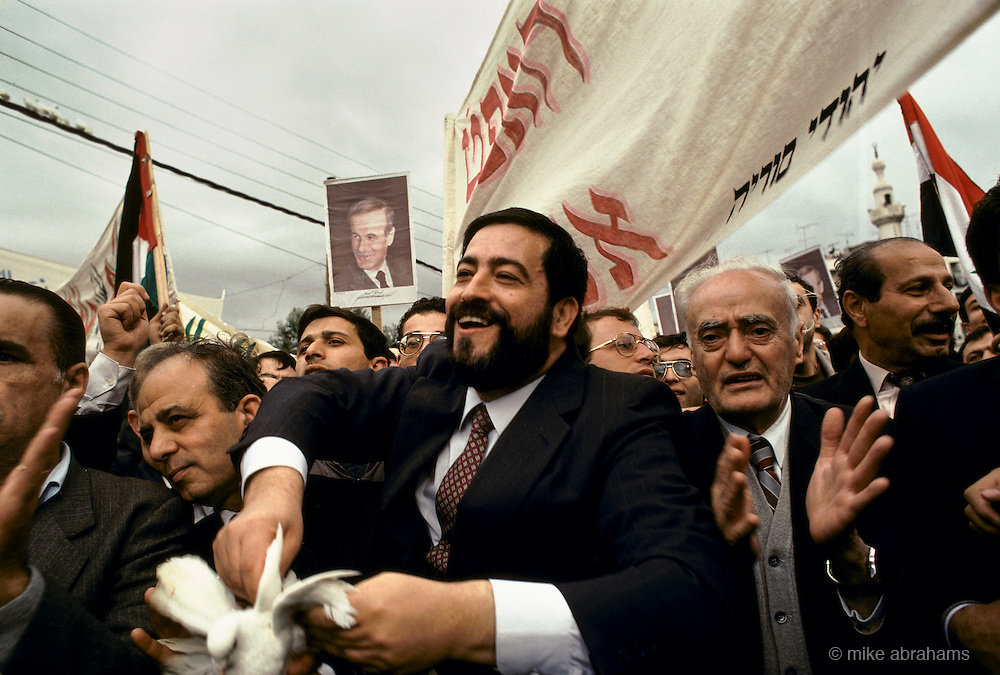 'JEWS IN SYRIA', CHIEF RABBI IBRAHIM HAMRA LIBERATING ONE OF 60 DOVES IN A PRE-ELECTION PROCESSION IN SUPPORT OF ASSAD