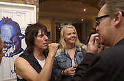 Jeff Beck and Sandra Cush. Vic Reeves exhibition. Britart.com. 4 July 2002. © Copyright Photograph by Dafydd Jones 66 Stockwell Park Rd. London SW9 0DA Tel 020 7733 0108 www.dafjones.com