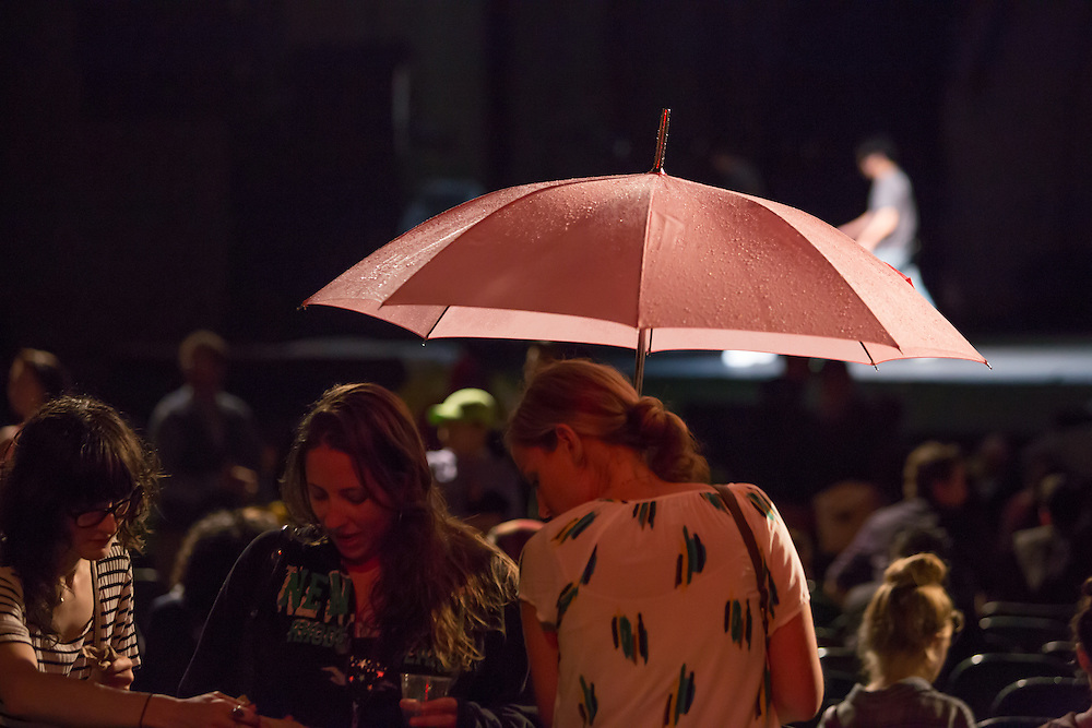 Most of the audience for The Ballets Jazz de Montréal sat under umbrellas for at least part of the performance, which was delayed by rain.