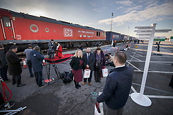 © Licensed to London News Pictures. 18/01/2017. London, UK. People have a photograph taken in front of first direct rail freight train from China as it arrives at Barking Rail Freight Terminal east of London. The new service set off from China on the 3rd of January this year. London is now the 15th European city to join what the Chinese government calls the New Silk Route. Photo credit: Peter Macdiarmid/LNP