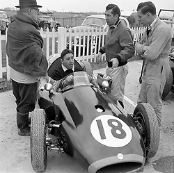 Left to right, CHARLES COOPER, ROY SALVADORI (in car) S.LEWIS-EVANS and TONY HARRIS at motor racing at Goodwood Race track, Sussex in 1958.