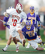 SHOT 5/11/13 7:29:26 PM - Denver's Cameron Flint #18 chases after a loose ball in front of Albany's Tim Cox #13 during their first round NCAA Tournament lacrosse game at the Peter Barton Lacrosse Stadium on the University of Denver campus Saturday May 11, 2013. The University of Denver won the game 19-14 to advance. (Photo by Marc Piscotty / © 2013)