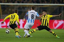 09-04-2013 VOETBAL: UEFA CL BORUSSIA DORTMUND - MALAGA CF: DORTMUND<br />  Mario Goetze (#10 Dortmund), Ignacio Camacho (#6 Malaga), Ilkay Gondogan / Guendogan (#8 Dortmund)<br /> ***NETHERLANDS ONLY***<br /> ©2013-FotoHoogendoorn.nl
