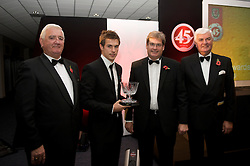 CARDIFF, WALES - Wednesday, November 11, 2009: Wales' Aaron Ramsey is presented with the Young Welsh Player of the Year trophy by President Phil Pritchard, SA Brains' Chairman John Rhys and General Secretary David Collins during the Football Association of Wales Player of the Year Awards hosted by Brains SA at the Cardiff City Stadium. (Pic by David Rawcliffe/Propaganda)
