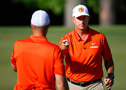 Clemson  head football coach Dabo Swinney reacts with Former Clemson punter and current assistant football coach Bill Spiers during the Chick-fil-A Peach Bowl Challenge at the Ritz Carlton Reynolds, Lake Oconee, on Monday, April 30, 2019, in Greensboro, GA. (Paul Abell via Abell Images for Chick-fil-A Peach Bowl Challenge)