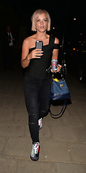 Singer Lily Allen leaving a photoshot in East London, wearing zip jeans with a black of the shoulder strap top and colourful nail polish to match jazzy trainers. London. UK. 12/08/2015<br />