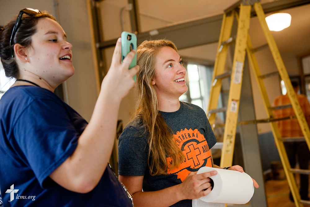 Megan Barz and Elizabeth Grobner (holding phone) of Lutheran Young Adult Corps serve Thursday, Aug. 10, 2017, at Eagle College Prep in south St. Louis. LCMS Communications/Erik M. Lunsford