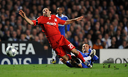 Ricardo Carvalho of Chelsea challenges Javier Mascherano of Liverpool during the UEFA Champions League Quarter Final Second Leg match between Chelsea and Liverpool at Stamford Bridge on April 14, 2009 in London, England.