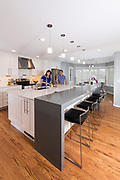 Happy couple cooking in their modern kitchen. Photo by Brandon Alms Photography.