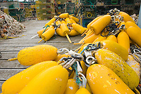 Yellow lobster buoys on dock Bristol Maine USA