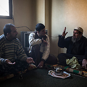 Syrian refugees from the same family discuss, on december 22nd 2013 in their appartment in Irbid.