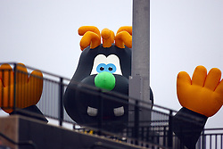 09 June 2011: Mascot Corny in the kids play section looks over the grandstand railing during a game between the Lake Erie Crushers and the Normal Cornbelters at the Corn Crib in Normal Illinois.