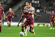 Ipswich Town defender Kane Vincent-Young (24) battles for possession  with Milton Keynes Dons midfielder Brennan Dickenson (11) during the EFL Sky Bet League 1 match between Milton Keynes Dons and Ipswich Town at stadium:mk, Milton Keynes, England on 17 September 2019.